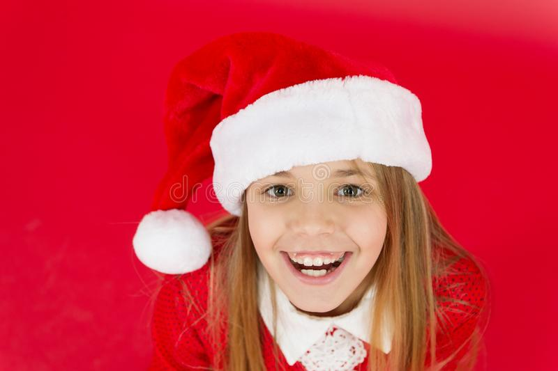 Good vibes. Positivity concept. Cheerful mood. Christmas party. Winter holidays. Playful mood. Christmas celebration. Ideas. Child Santa Claus costume hat close royalty free stock photos