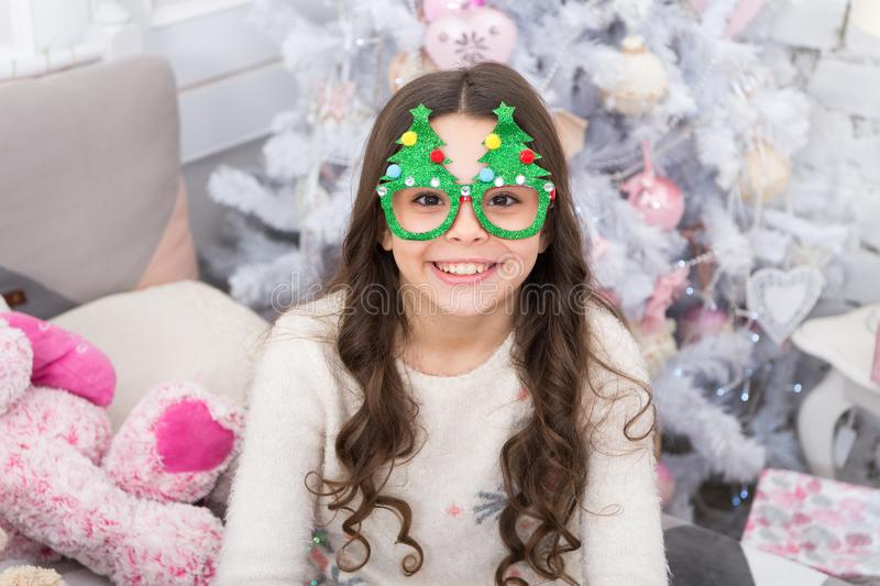 Good vibes. Winter holidays. Kid relaxing. Adorable little girl wear christmas tree glasses photo booth props. Rest and. Relax. Christmas eve. Small girl at stock photography