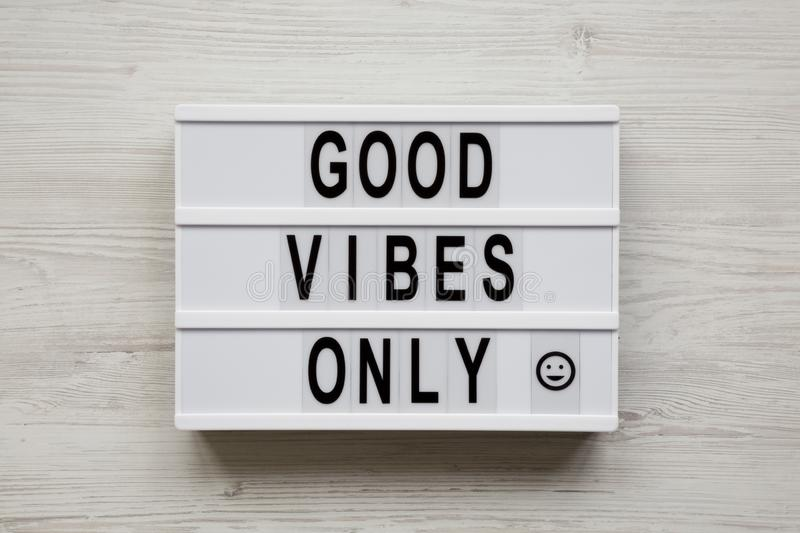 `Good vibes only` words on a modern board on a white wooden surface, top view. From above, overhead, flat lay.  royalty free stock photos