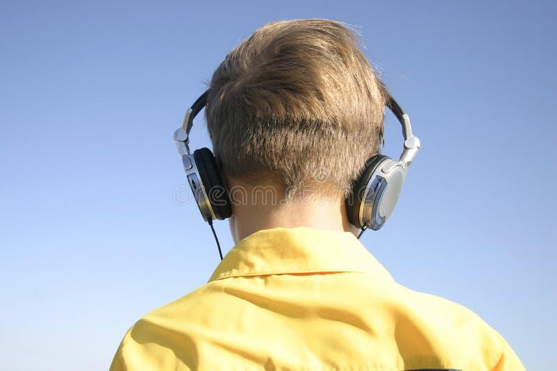 Good vibrations. Boy with headphones royalty free stock photo