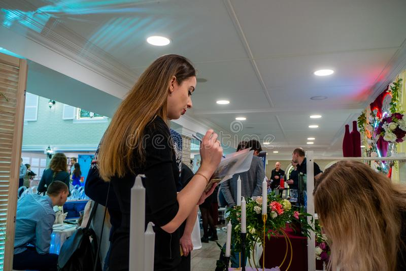 A lady checking a list at a wedding exhibition royalty free stock photo