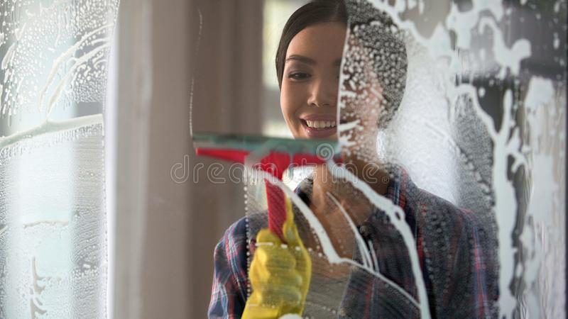 Good wife with pleasure cleaning house and washing room windows, order at home. Stock footage stock photo