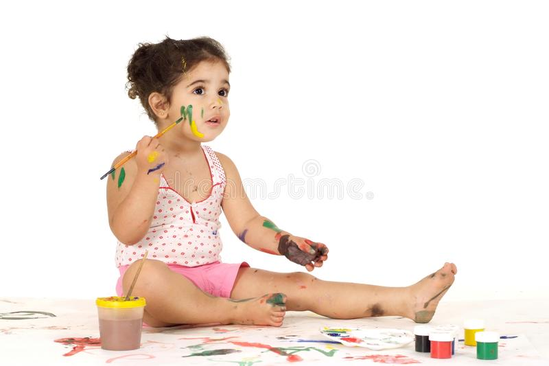 Good young girl draws painting while sitting on the floor royalty free stock photo