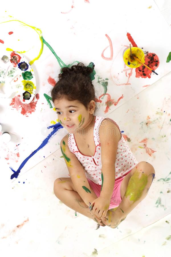 Good young girl draws with paints on a white royalty free stock photos
