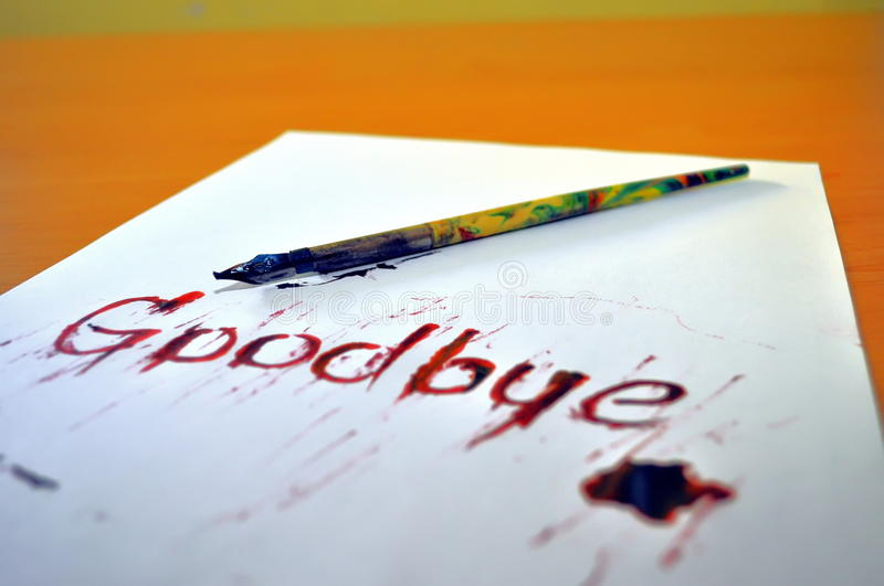 Goodbye. Red ink goodbye letter with pencil stock photos