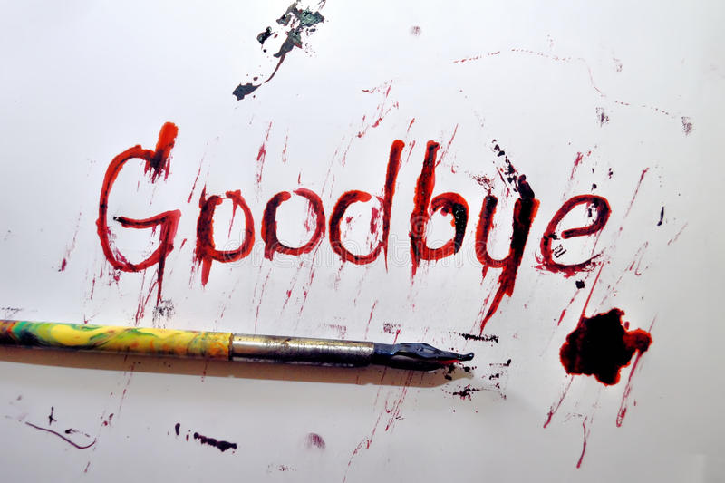Goodbye. Red ink goodbye letter with pencil royalty free stock photography