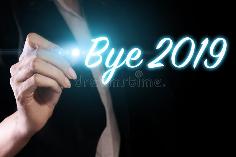 Goodbye 2019 with hand stock photos