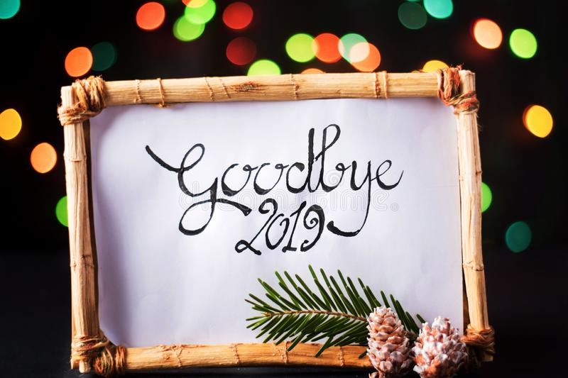 Goodbye 2019 New Year note with colorful background. Goodbye 2019 New Year note with colorful festive background, 2020, calligraphy, handwritten, bokeh, fir stock photos