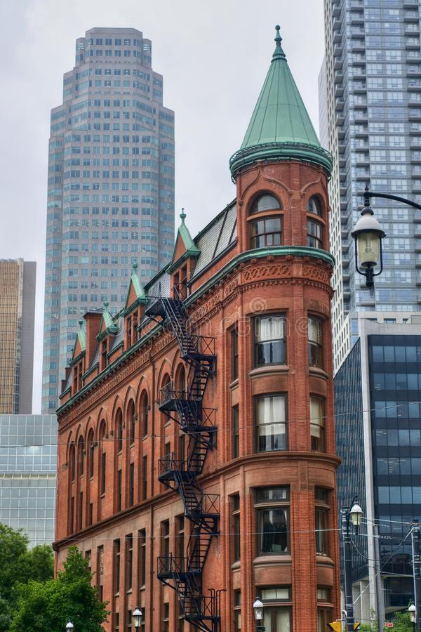 The Gooderham Building in Toronto, Canada. Vertical view. The Gooderham Building, aka the Flatiron Building, historic office building on Wellington Street East royalty free stock photo