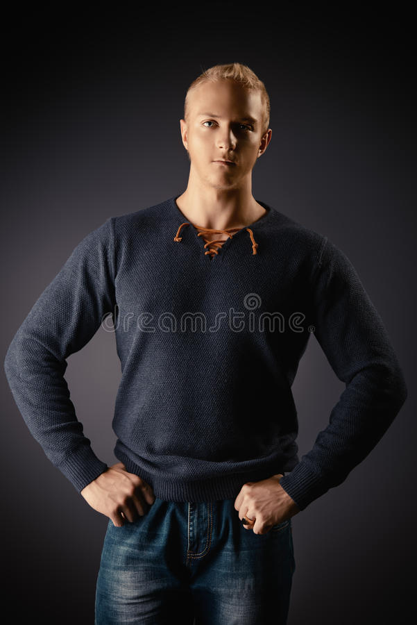 Goodlooking man. Fashion portrait of young masciline man posing over dark background stock images