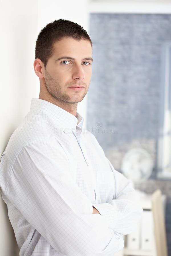 Goodlooking man standing arms crossed. Goodlooking young man standing arms crossed stock image