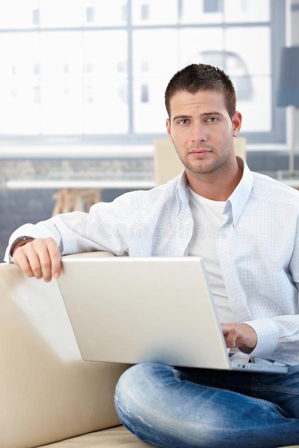 Goodlooking Man Working At Home On Laptop Stock Image