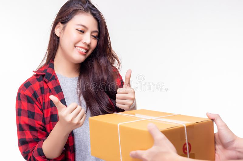 Goods delivery send package to beautiful woman very quickly. It send from foreign country. Attractive beautiful girl get satisfied royalty free stock image