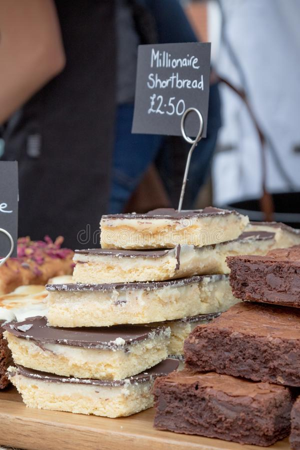 Goods for sale at Farnham Food Festival. Farnham, United Kingdom, 30th October 2017:-Baked treats for sale at Farnham International Food Festival royalty free stock images