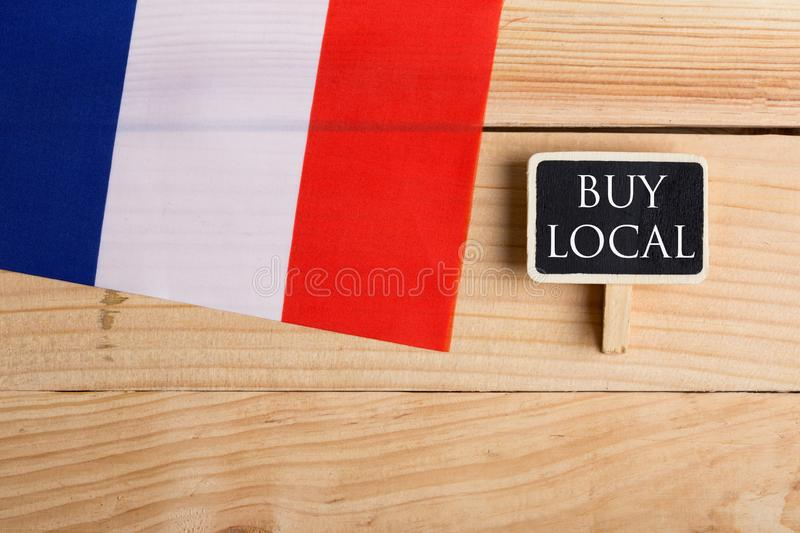 Goods and services concept - french country& x27;s flag, blackboard with text Buy local. On wooden background, france, made, label, chalkboard, product, quality stock photo