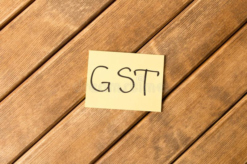 Goods and services and Tax . GST the inscription on the wooden stock photography
