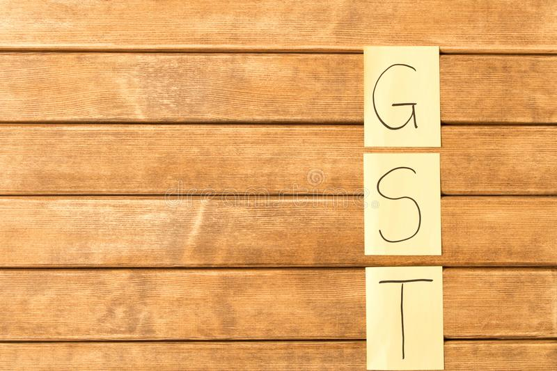 Goods and services and Tax . GST the inscription on the wooden royalty free stock image