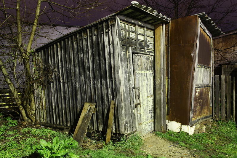 Goods shed. Shed facilities night wood chalets storage room tin old antique shanty tool hut barrack royalty free stock photography