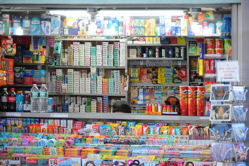 Goods on shelves in store. Different goods displayed on shelves in a store stock image