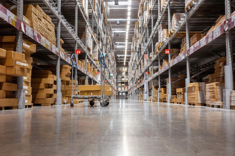 Goods shelves of warehouse handling management, Products storehouse interior and distributor shopping mall., Business cunsumer royalty free stock photo