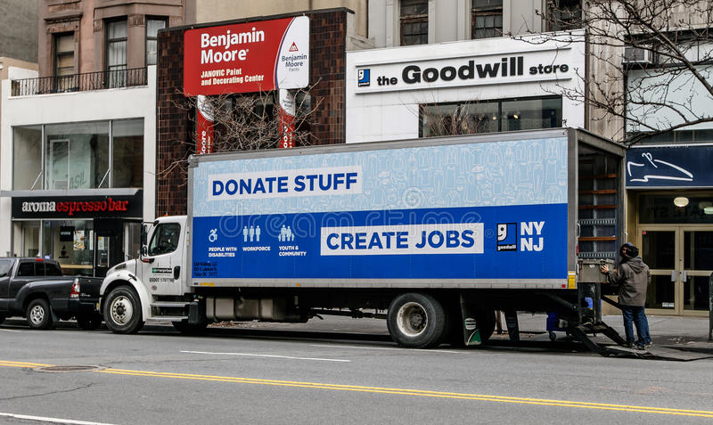 Goodwill truck is parked in front of their store stock photography