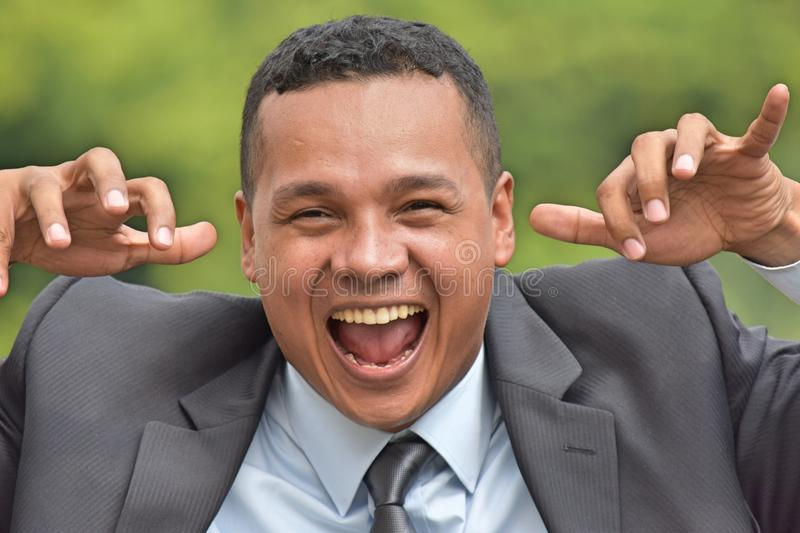 Goofy Business Executive Wearing Suit And Tie. A handsome adult hispanic man royalty free stock photos