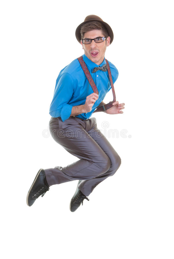 Goofy business man jumping. Goofy business man with hat and braces jumping stock photography