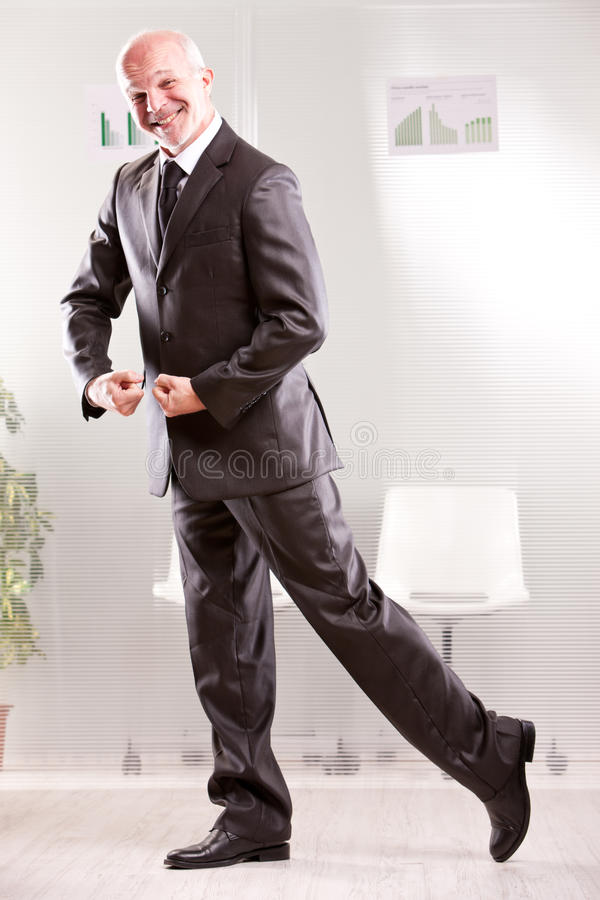 Goofy businessman pretending weightlifting. With his arms and foolish face royalty free stock photography
