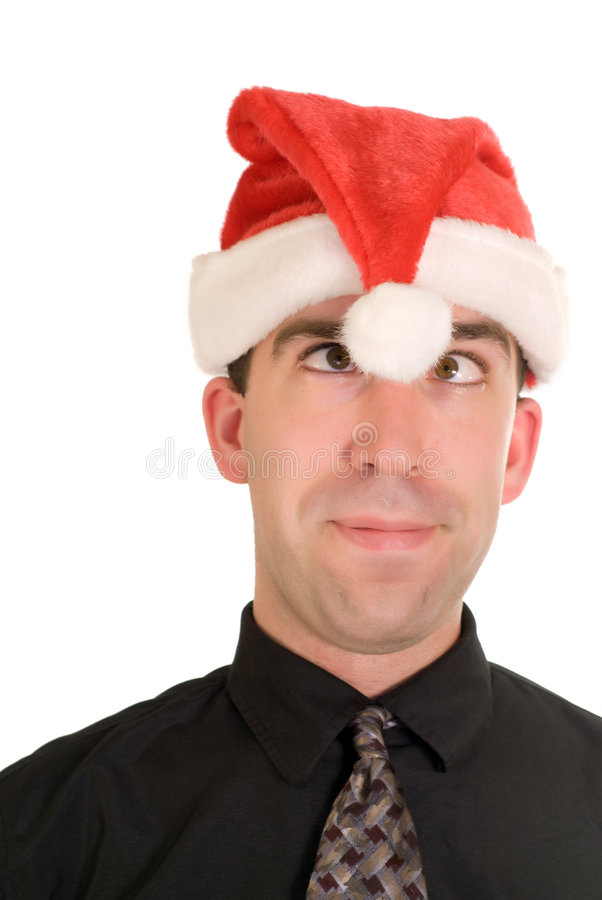 Goofy Christmas. A young businessman wearing a santa hat and acting goofy royalty free stock photos