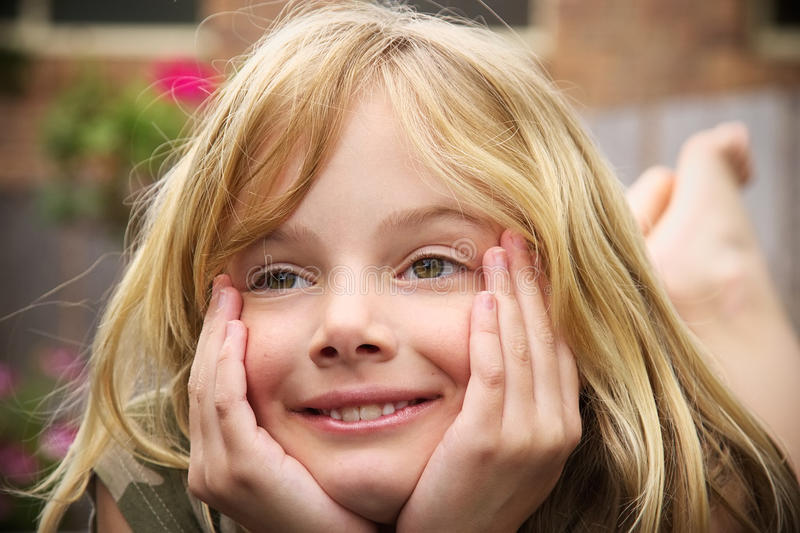 Goofy day dreamer. A little girl with a goofy, daydreaming expression royalty free stock images