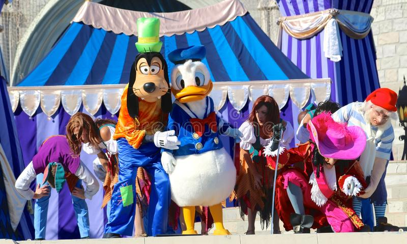 Goofy and Donald duck at Disneyworld. Goofy and Donald duck on stage at Disney's Magic Kingdom in Orlando, Florida stock images
