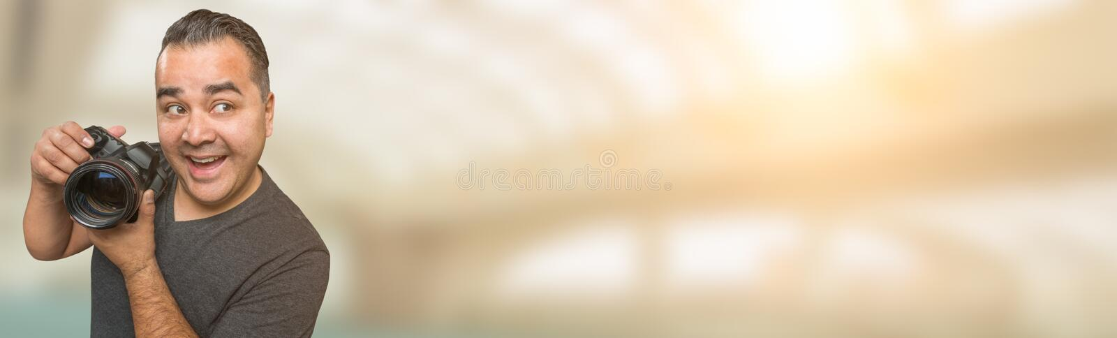 Goofy Hispanic Man with DSLR Camera Wide Banner with Room For Co. Py stock images