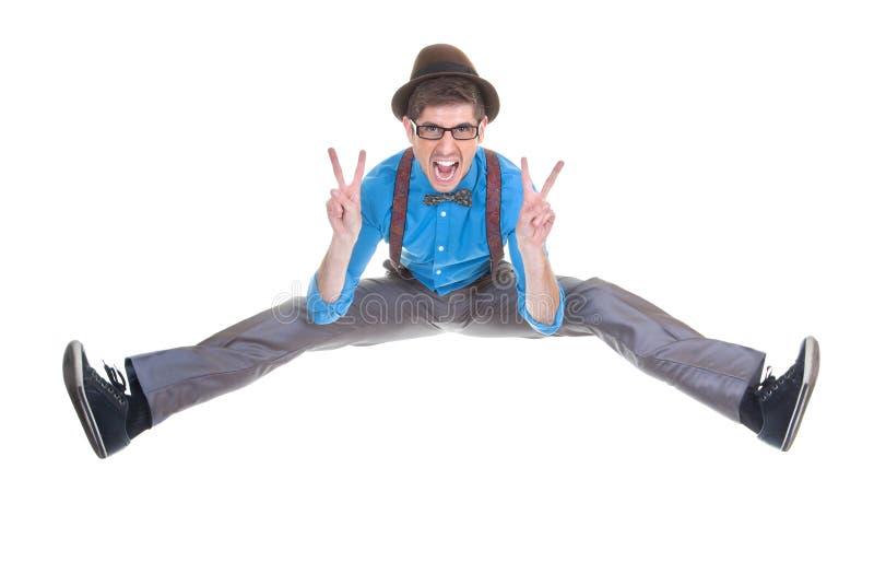 Goofy, nerd geek jumping with v sign. Goofy, nerd geek jumping and shouting with v sign stock photography