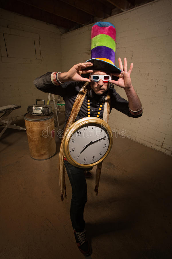 Goofy Poser with Large Clock. Man with 3D glasses tall hat and large clock stock image