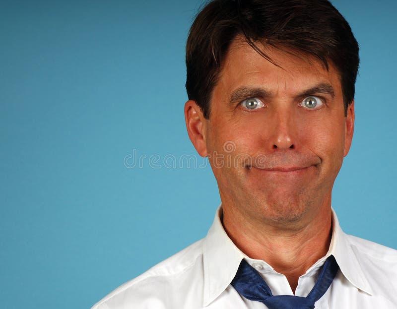 Goofy Salesman. Portrait of a Foolish goofy salesman with funny expression stock photo