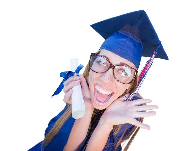 Goofy Young Girl Graduates In Cap and Gown Isolated on White. Goofy Graduating Young Girl In Cap and Gown Isolated on a White Background stock photos