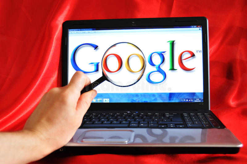 Google. Hand and magnifying glass - Google search concept