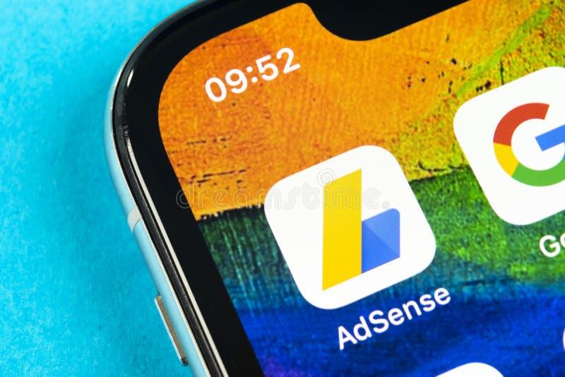 Google AdSense application icon on Apple iPhone X screen close-up. Google AdSense app icon. Google AdSense application. Social med. Helsinki, Finland, May 4 royalty free stock photography