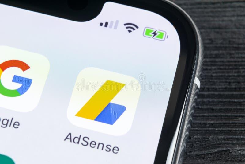 Google AdSense application icon on Apple iPhone X screen close-up. Google AdSense app icon. Google AdSense application. Social med. Sankt-Petersburg, Russia stock image