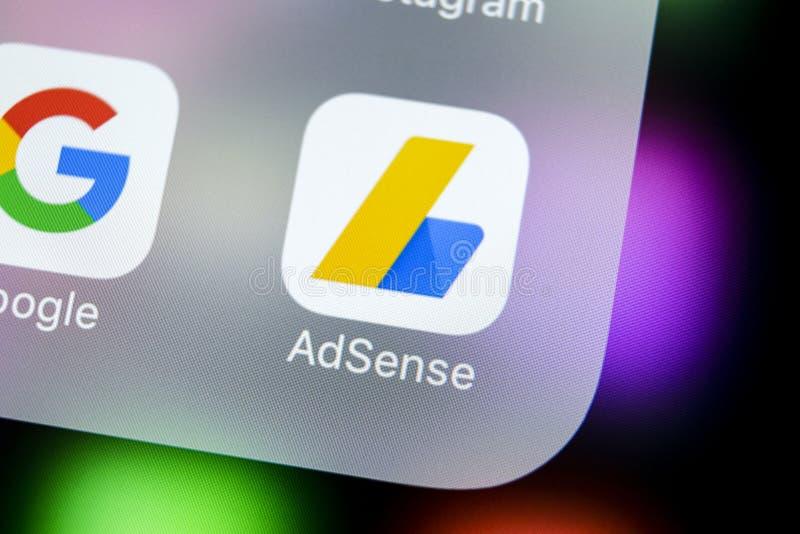 Google AdSense application icon on Apple iPhone X screen close-up. Google AdSense app icon. Google AdSense application. Social me. Sankt-Petersburg, Russia royalty free stock photography