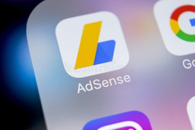Google AdSense application icon on Apple iPhone X screen close-up. Google AdSense app icon. Google AdSense application. Social med. Sankt-Petersburg, Russia royalty free stock photos
