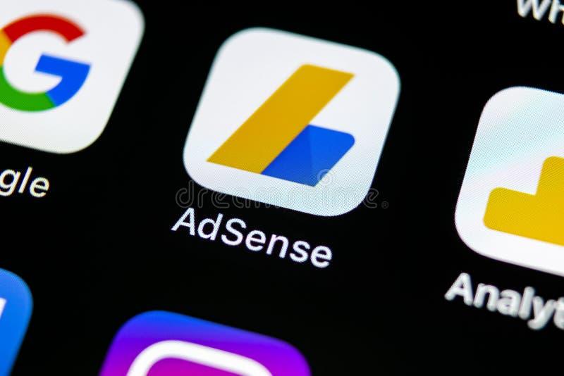 Google AdSense application icon on Apple iPhone X screen close-up. Google AdSense app icon. Google AdSense application. Social med. Sankt-Petersburg, Russia, May stock image