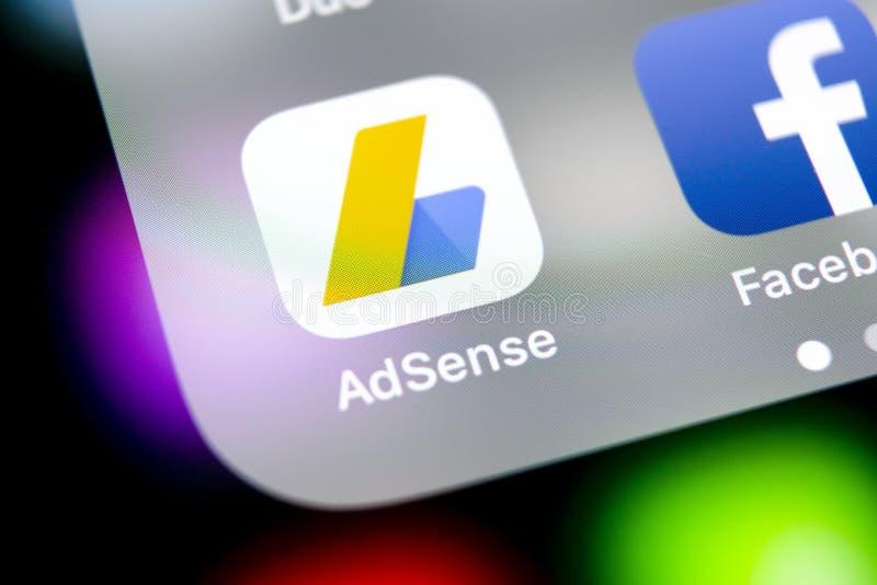 Google AdSense application icon on Apple iPhone X screen close-up. Google AdSense app icon. Google AdSense application. Social med. Sankt-Petersburg, Russia stock images