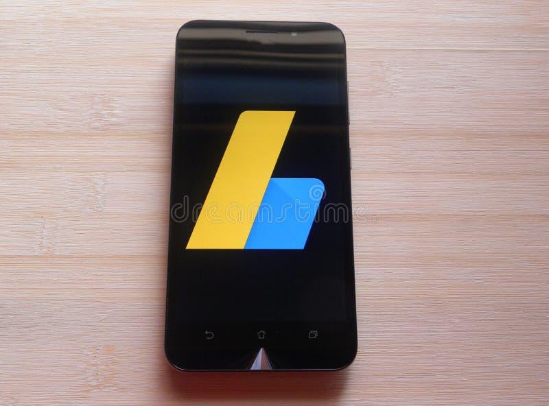 Google AdSense. App on smartphone kept on wooden table stock photo