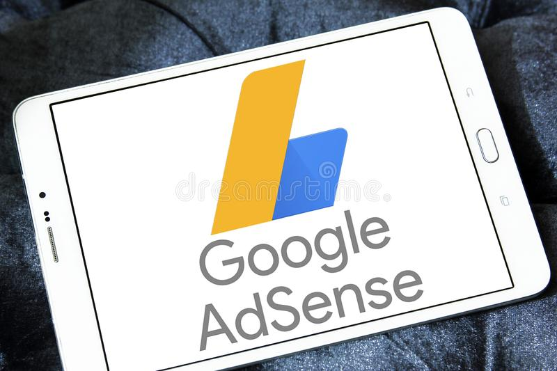 Google AdSense logo. Logo of Google AdSense on samsung tablet. Google AdSense is a program run by Google that allows publishers in the Google Network of content stock image
