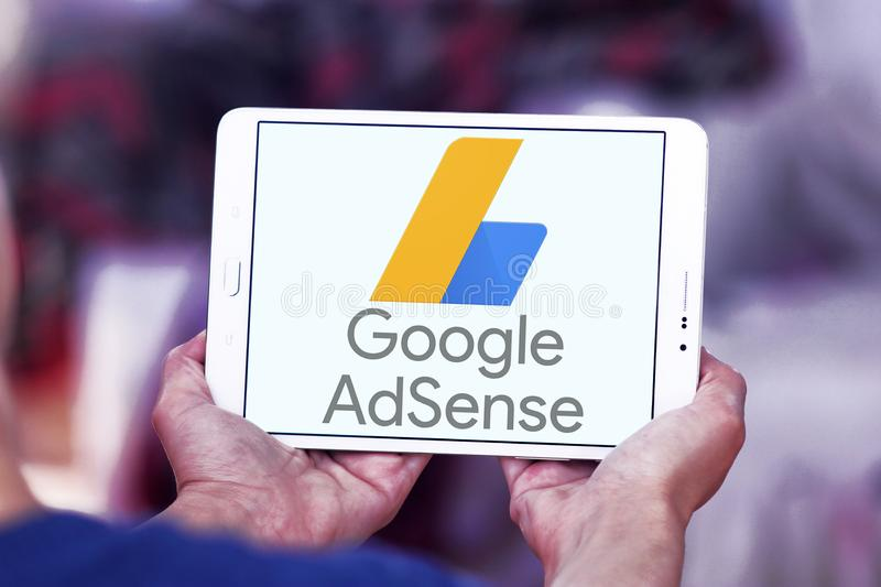 Google AdSense logo. Logo of Google AdSense on samsung tablet . Google AdSense is a program run by Google that allows publishers in the Google Network of content stock images