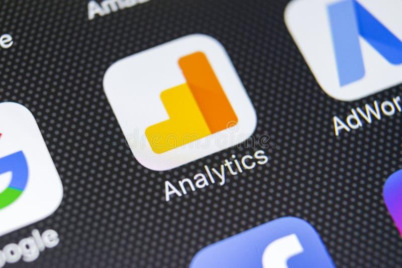 Google Analytics application icon on Apple iPhone X screen close-up. Google Analytics icon. Google Analytics application. Social stock photography