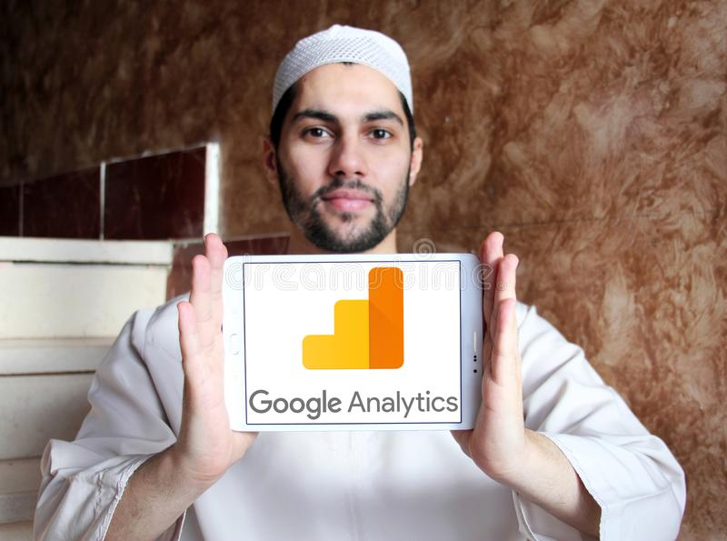 Google Analytics logo. Logo of Google Analytics on samsung tablet holded by arab muslim man. Google Analytics is a freemium web analytics service offered by stock image