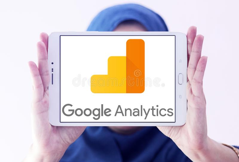 Google Analytics logo. Logo of Google Analytics on samsung tablet holded by arab muslim woman. Google Analytics is a freemium web analytics service offered by stock photography