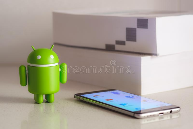 Google Android figure with books in the background royalty free stock image